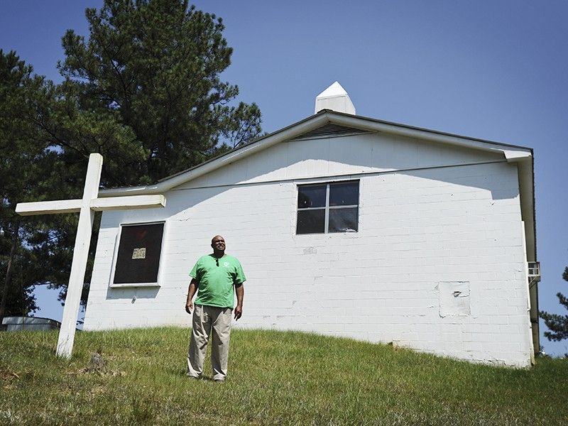 Ron Smith stands outside New Zion Church, next to Stone's Throw landfill, near Tallassee, Ala. Community members meet at this church regularly to discuss issues related to the landfill.