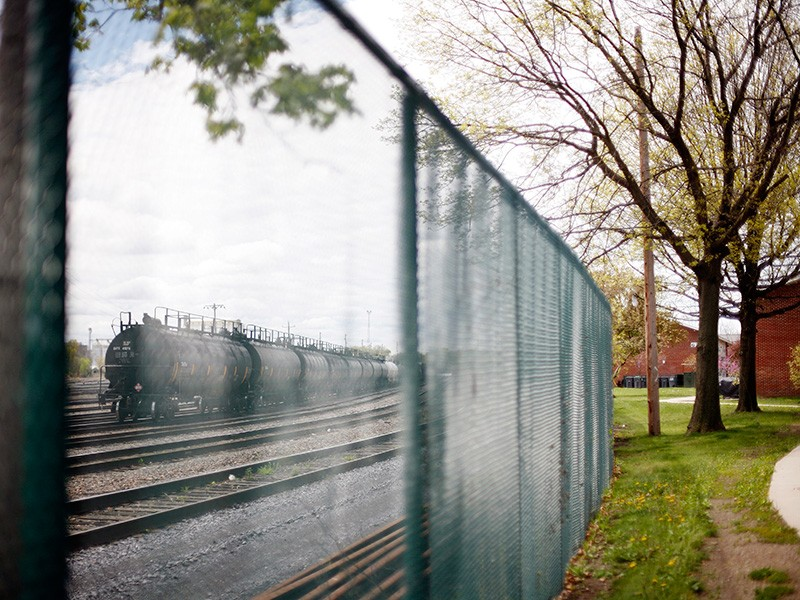 Tank cars, on a track adjacent to Ezra Prentice Homes in Albany's South End.