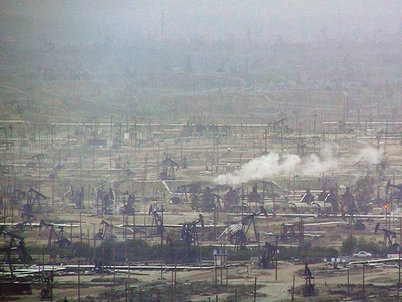 Hazy air covers an active drilling field in California.