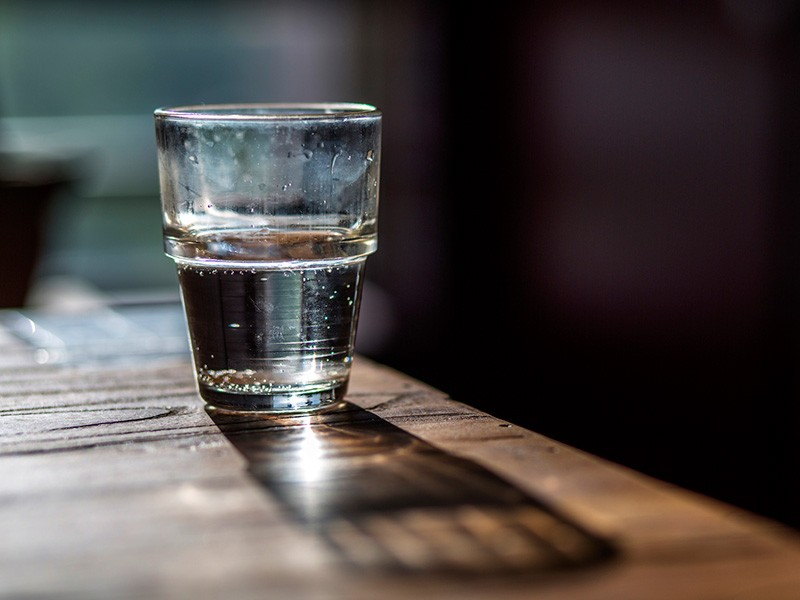 A glass of drinking water.