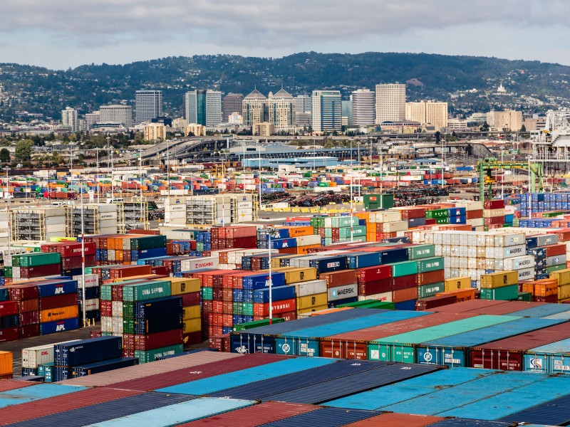 Shipping containers pile high at the Port of Oakland.