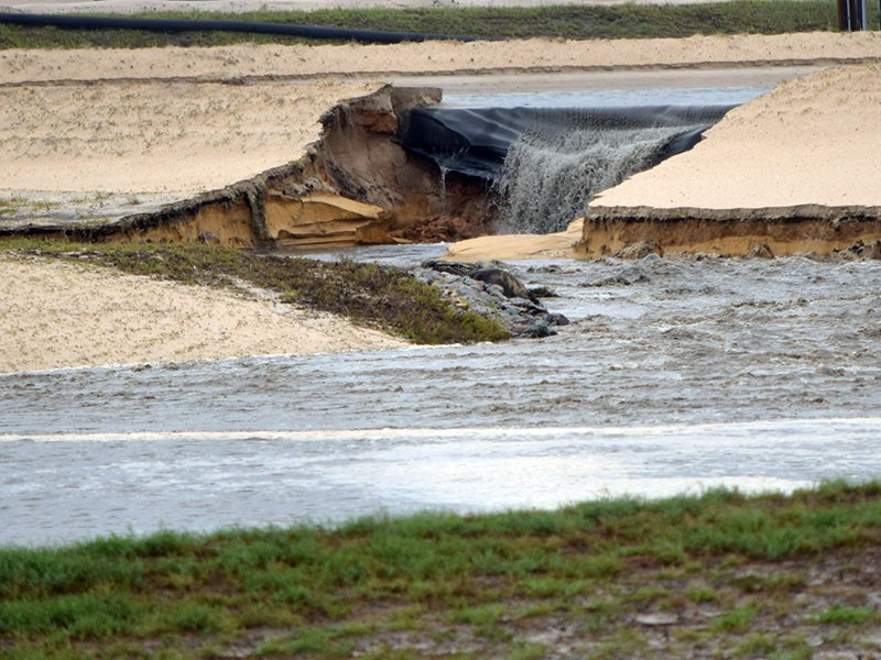 Toxic coal ash leaks from a breached pond at the L.V. Sutton Power Station outside Wilmington, North Carolina, following Hurricane Florence in Sept. 2018.