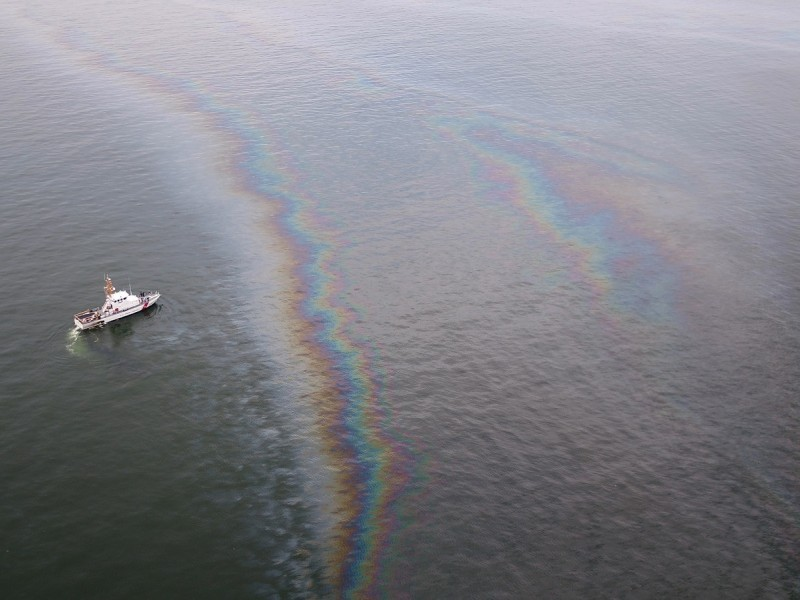 A boat monitors the oil sheen from the Taylor Energy leak.