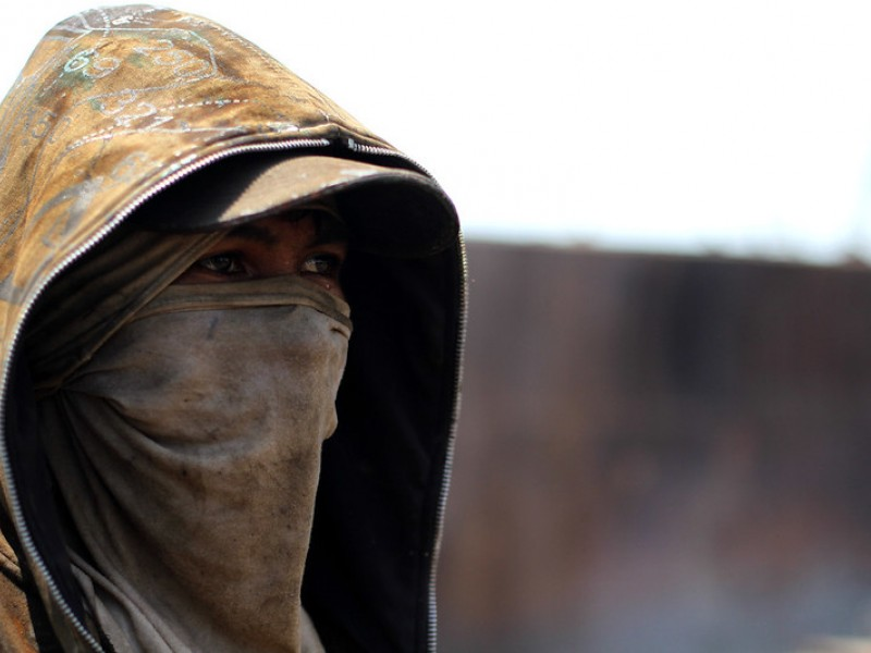 A shipbreaker in Jakarta wears a makeshift face mask. Jakarta has some of the most polluted air of any capital city.