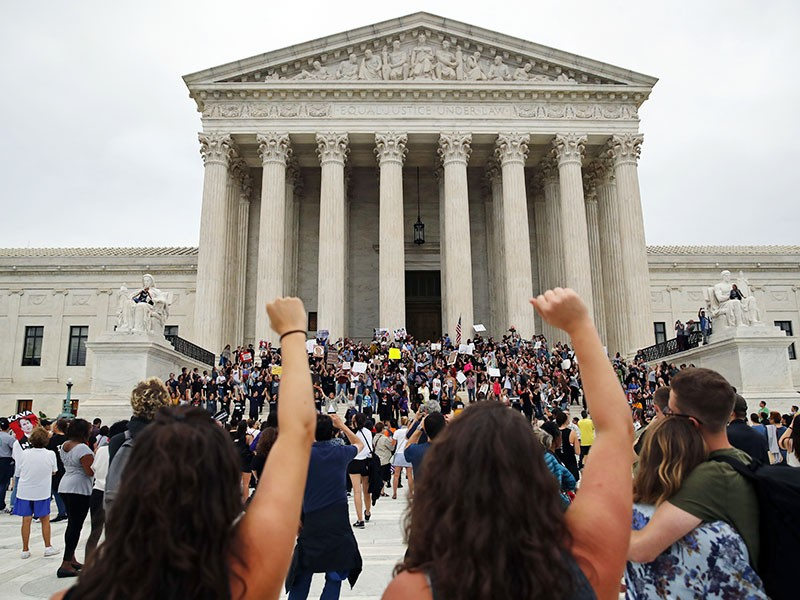 Activists protest outside the Supreme Court as Justice Brett Kavanaugh is sworn in.