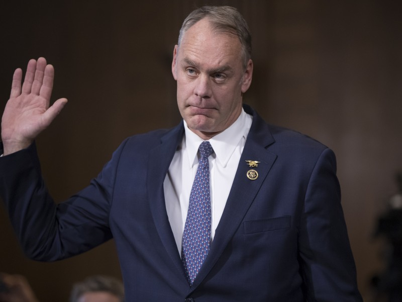 Interior Secretary Ryan Zinke is sworn in on Capitol Hill in January 2017.