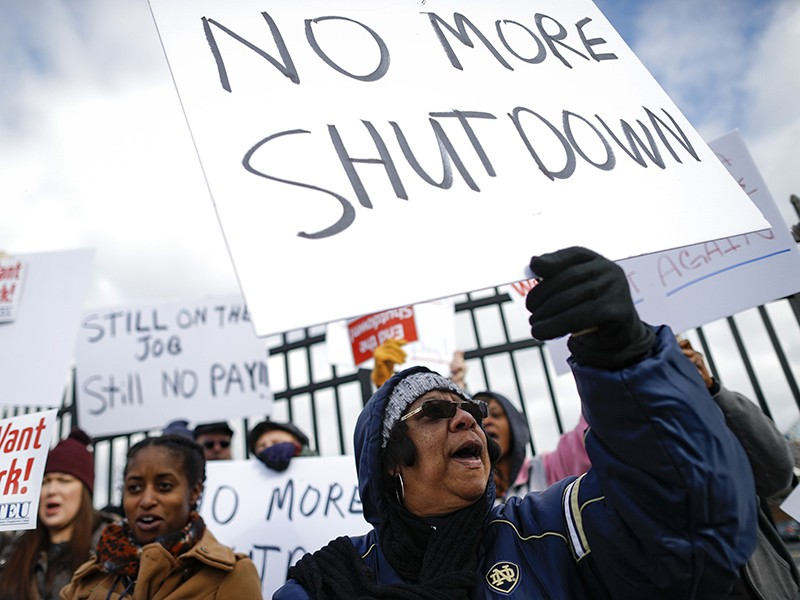 Union members and IRS workers rallied against the federal government shutdown in Covington, Kentucky, on Jan. 10, 2019.