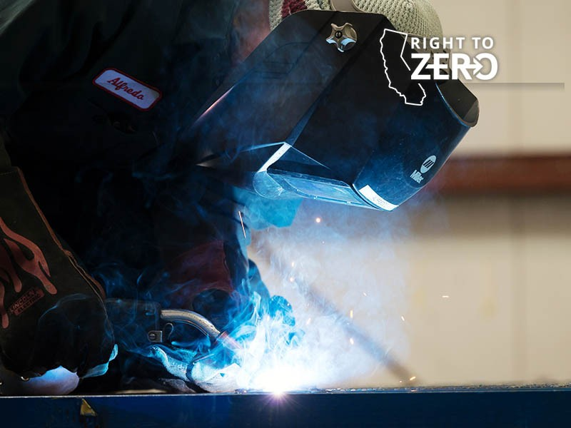 This welder is one of hundreds of full-time workers employed by electric bus manufacturer BYD at the company's factory in California.