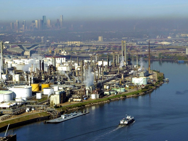 A haze of smog covers the Port of Houston. In a $20 million victory for public health, a citizen suit made ExxonMobil pay for violating the Clean Air Act at a facility in this area.