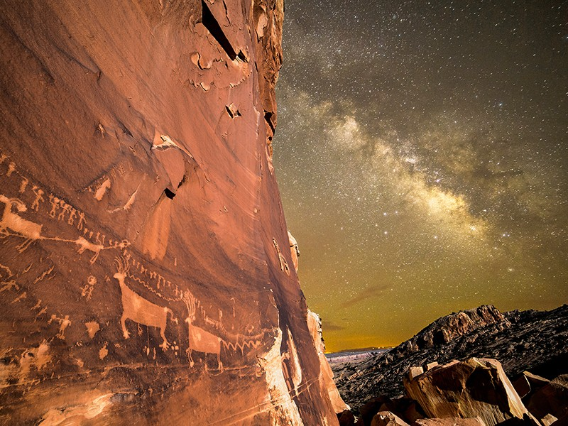 The night sky illuminates a wall of petroglyphs at Utah's Bears Ears National Monument.