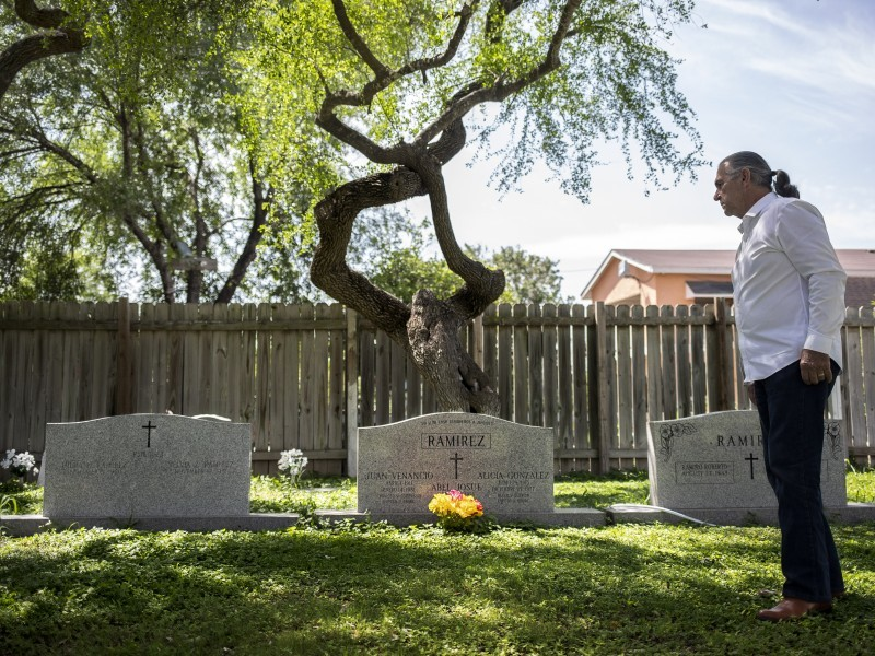 Ramiro Ramirez visits his parents' graves at Jackson Ranch Cemetery in Texas.