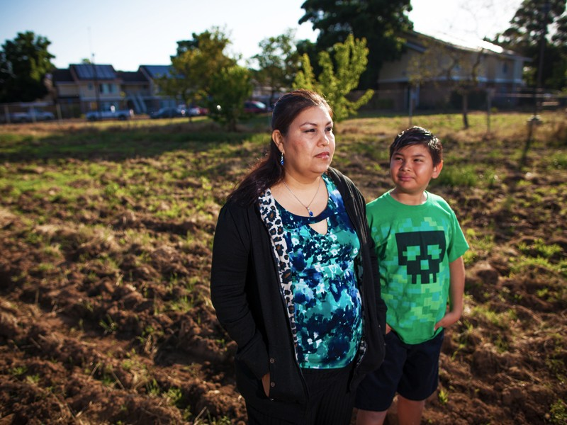 Claudia Angulo and her son Isaac in Orange Cove, CA.