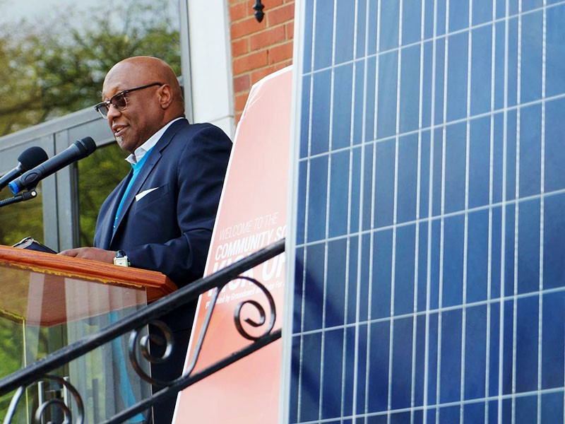 Pastor Marcus Harris of the Dupont Park Seventh Day Adventist Church speaks at an event to celebrate solar panels being installed on the church.