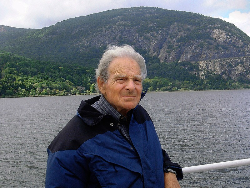 David Sive on the Hudson River, with Storm King Mountain in the background.