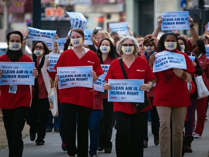 Members of the California Nurses Association march to a rally outside the EPA's public hearing on updating ozone protections, in Sacramento, CA, on February 2, 2015.