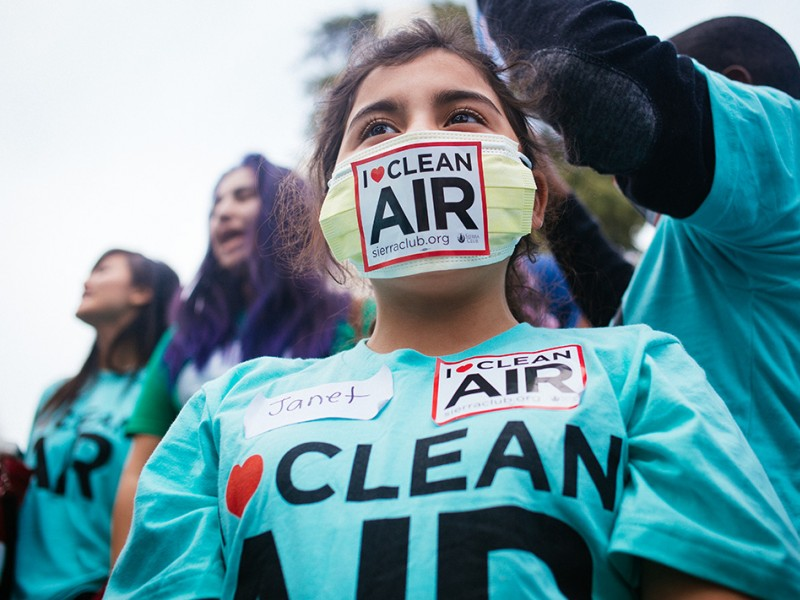 Janet, a fifth grader from Oakland, California, wears a symbolic mask, as she attends a public hearing held by the Environmental Protection Agency on strengthening the ozone pollution standard, February 2, 2015.