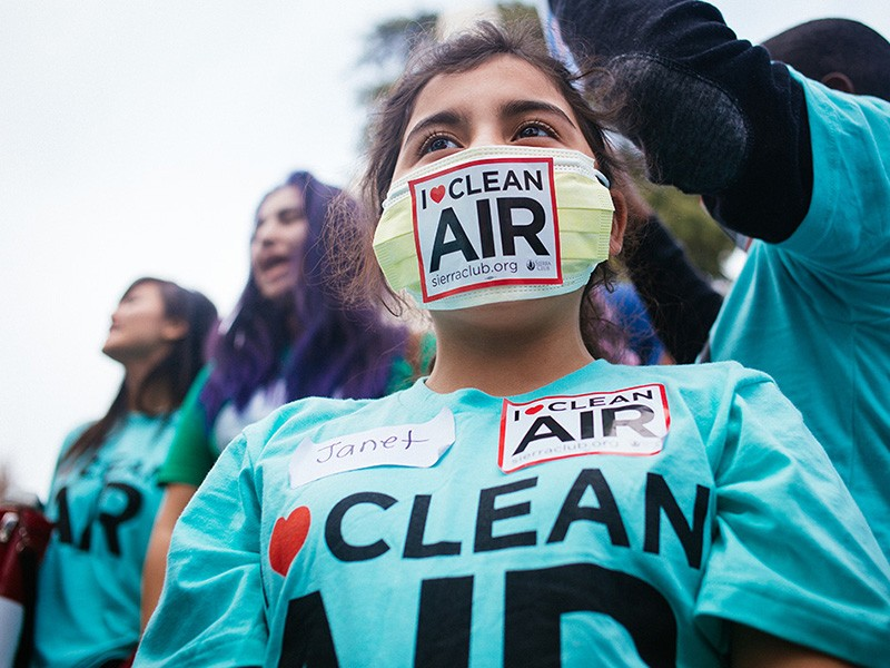 """Janet Rodriguez, a fifth grader from Oakland, Calif., wears a mask adorned with an """"I Love Clean Air"""" logo at a rally outside of the EPA Ozone hearing in Sacramento on Feb. 2, 2015."""