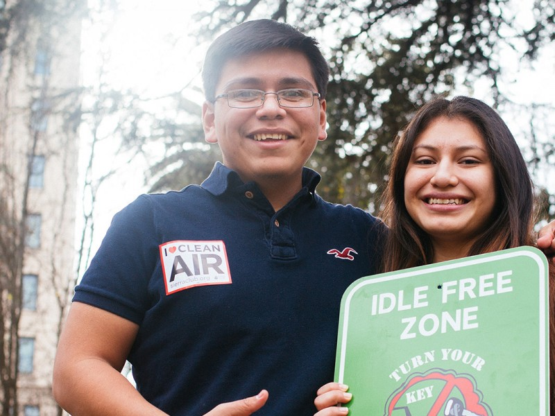 Oscar Garcia and Kimberly Garcia of Reno, NV, hold a sign outside of the EPA's public hearing in Sacramento on proposed ozone standards.