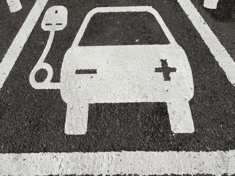 Parking spot depicting an electric car charging