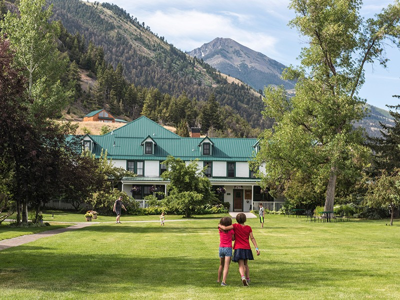 The front lawn of the world famous, locally-owned, Chico Hot Springs Resort. Emigrant Peak rises in background.