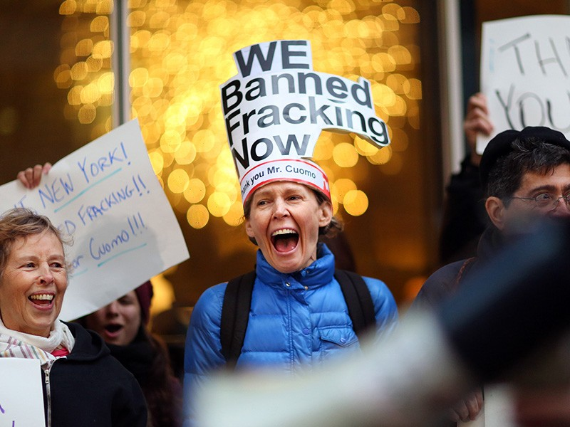 Leslie Roeder, an advocate with New Yorkers Against Fracking, celebrates in 2014 after Govenor Cuomo announced he would ban hydraulic fracking.