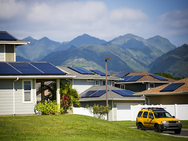 Solar panels on the rooftops of homes in the Salt Lake neighborhood of Oahu, Hawaii.