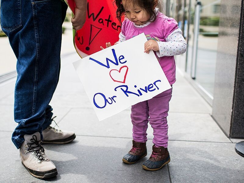 Young salmon supporter and Yurok Tribe member Tseeyaba, and her father, outside the Burton Federal Building on the day of a hearing on Klamath River flows in San Francisco, April 10, 2018.