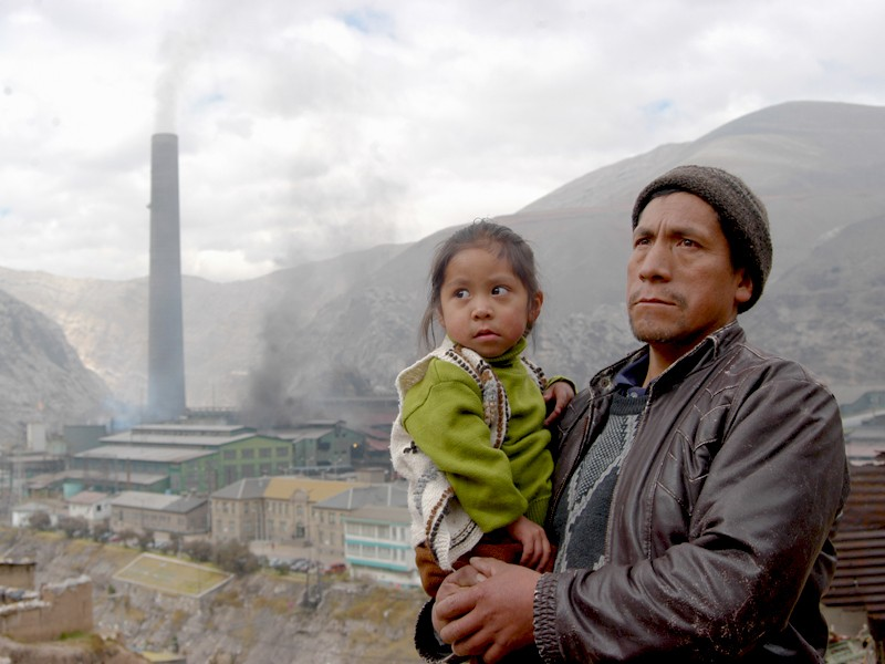Pablo and his daughter in front of the metal smelter in La Oroya in 2008
