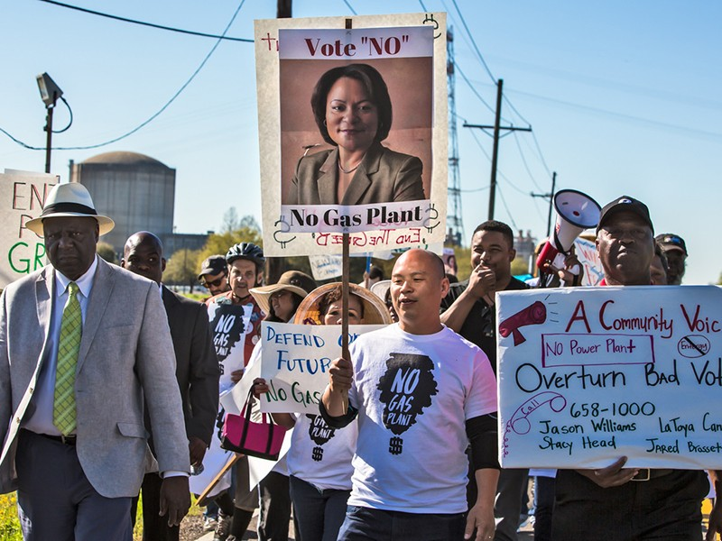Pat Bryant, left, leads a march against environmental racism and Entergy's proposed New Orleans East gas plant on March 3, 2018.