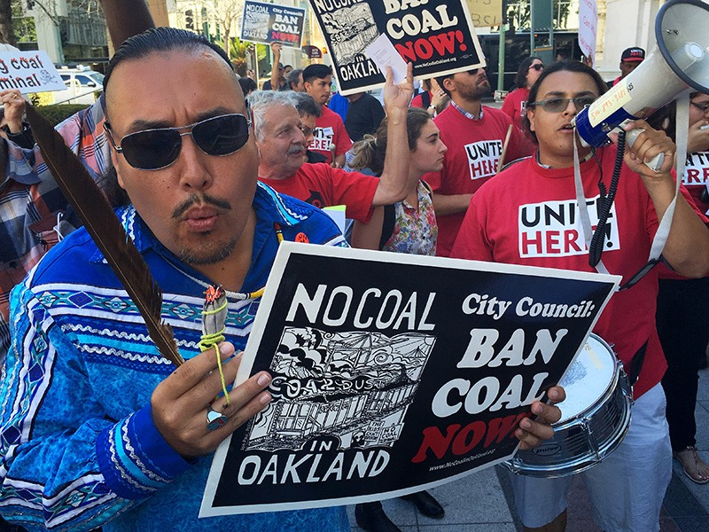 Opponents of the coal export proposal rally outside of Oakland City Hall on June 27, 2016.