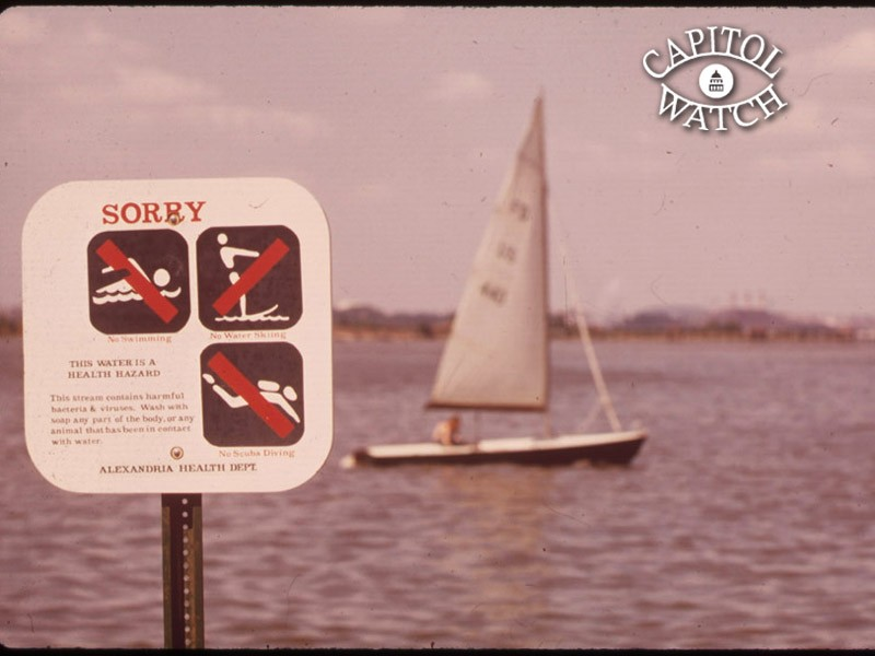 In August 1972, a sign warns that the Potomac Rive is unsafe for water sports due to pollution.