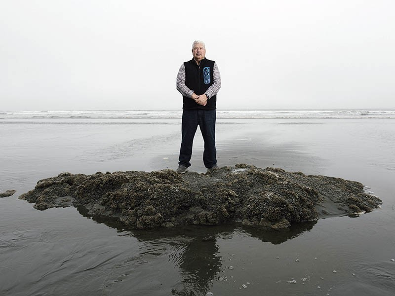Quinault tribal member Larry Ralston stands on the beach at the Quinault Indian Nation reservation. The tribe must relocate the village of Taholah uphill due to sea level rise.