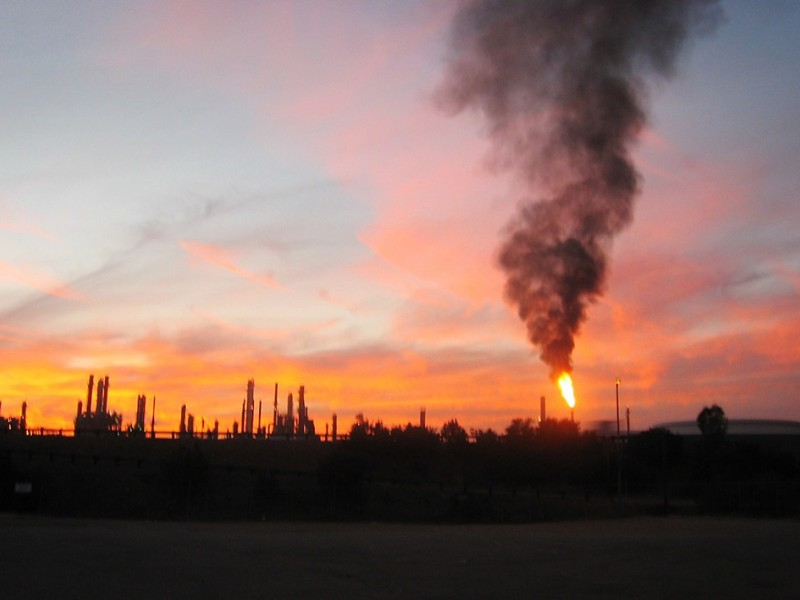 Air pollution emits from a refinery.