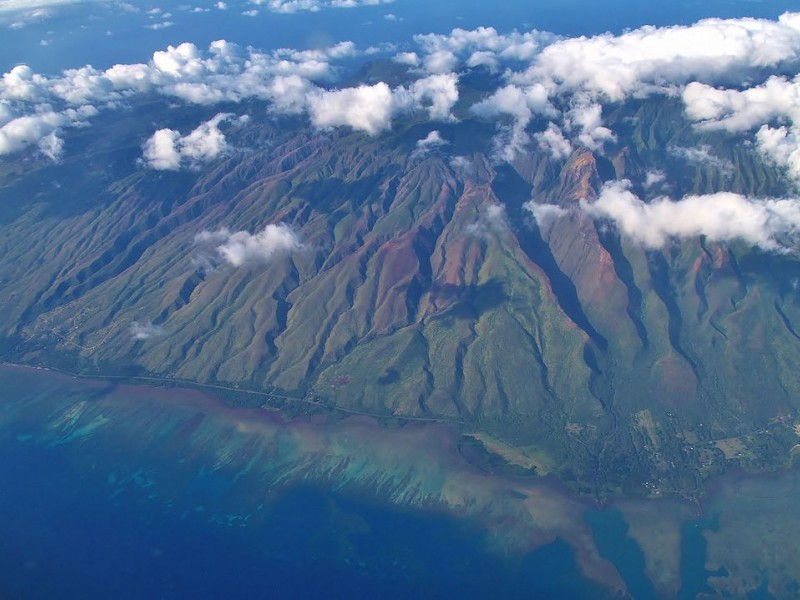 The South Shore of Moloka'i, with Kawela Valley on the left.  Moloka'i Ranch covers 55,575 acres, roughly one-third of the island. The Ranch's plantation-era stream diversions in Central Moloka'i take water from native streams to the island's dry west end
