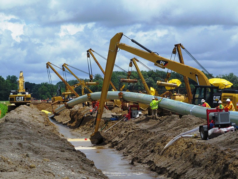 The construction of a natural gas pipeline in Michigan.