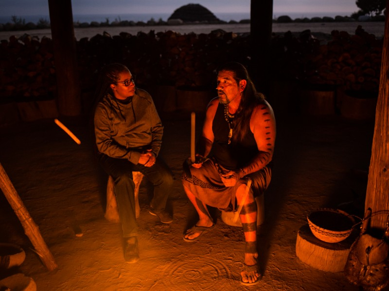 Angela Johnson Meszaros sits with Mati Waiya at Wishtoyo Village.