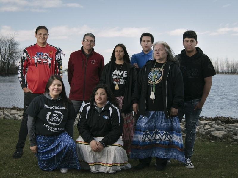 Menominee youth gather at the mouth of the Menominee River with Tribal Chairman Douglas Cox and high school teacher Dawn Wilber.