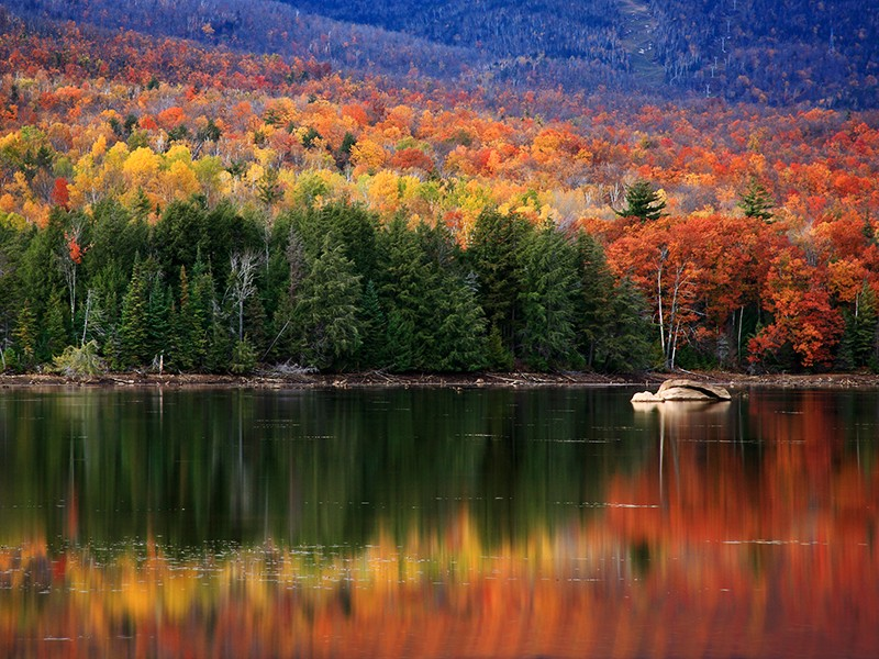 Trees in the Adirondacks change colors in the fall months drawing thousands of visitors every year.