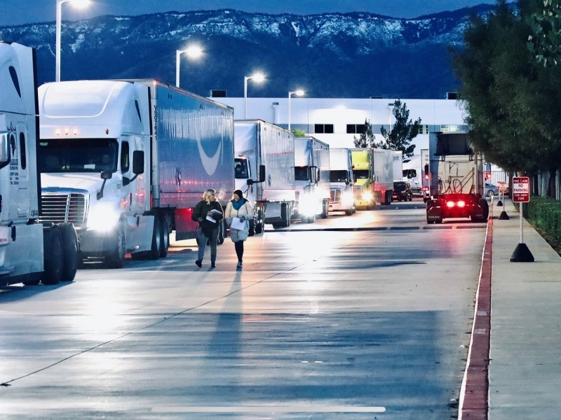 Trucks line up outside the Amazon ONT 2 and 5 facilities in San Bernardino.
