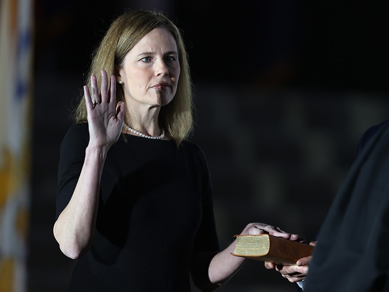 Justice Amy Coney Barrett is sworn in by Supreme Court Associate Justice Clarence Thomas on the South Lawn of the White House, Oct. 26, 2020.