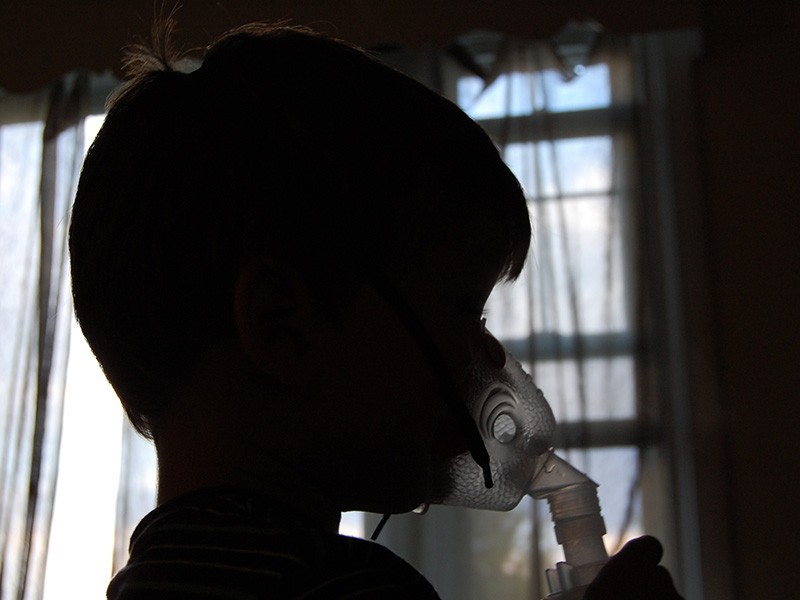 A child receives treatment for asthma.