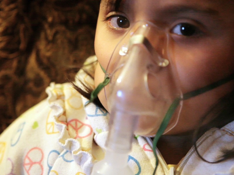 A child suffers from asthma.