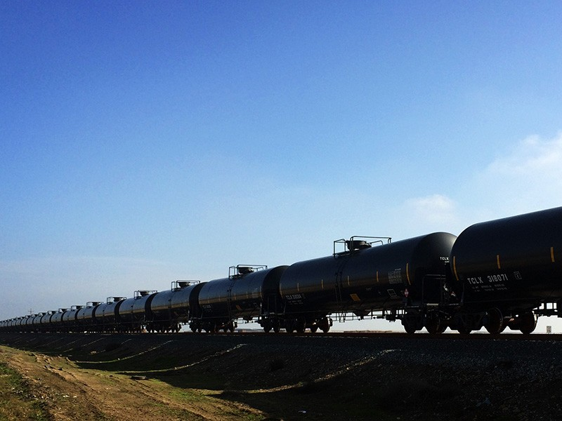 An oil train in California's Central Valley. Much of the oil shipped by these trains is either extremely toxic and heavy Canadian tar sands oil or the Bakken crude responsible for major explosions and fires in derailments across the continent.