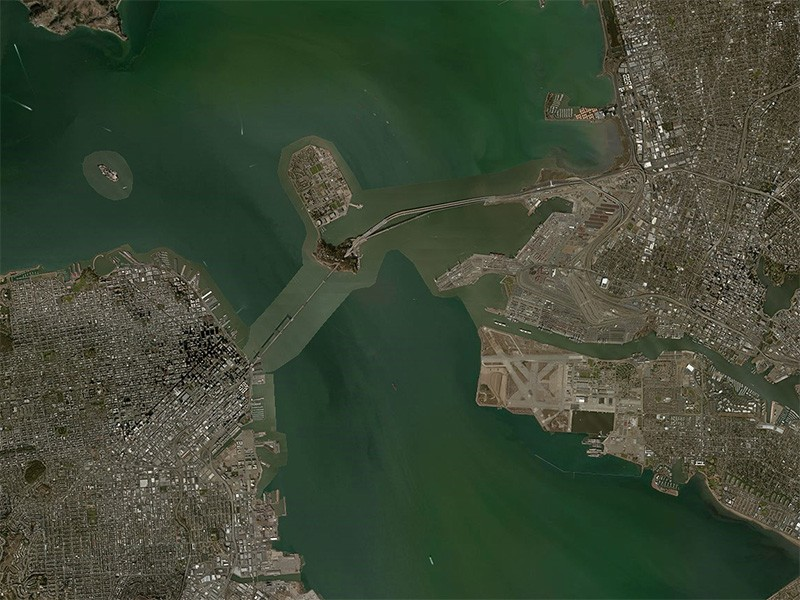 Aerial view of the San Francisco Bay. The coal export terminal would be developed on a piece of land right next to where the eastern end of the San Francisco Bay Bridge (center) touches down in Oakland.