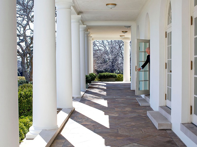 Then-Vice President Joe Biden opens a door from the Outer Oval Office onto the Colonnade of the White House on his way to a National Governors Association meeting, Feb. 24, 2014.
