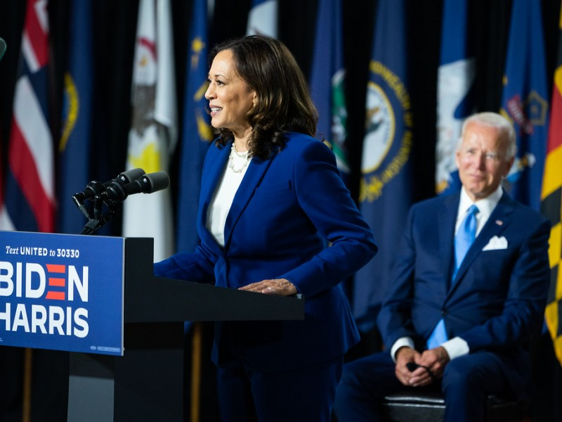 Photo of Senator Kamala Harris speaking, with Joe Biden seated in the background, in Wilmington, Del., following the announcement of her candidacy for vice president of the United States on August 12, 2020.