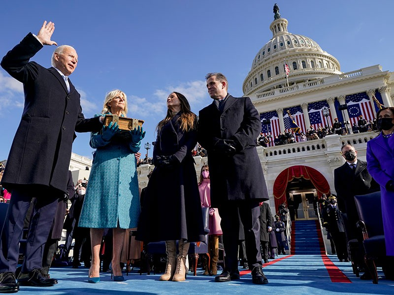 Joe Biden is sworn in as the 46th president of the United States by Chief Justice John Roberts as Jill Biden holds the Bible during the 59th Presidential Inauguration at the U.S. Capitol in Washington, Wednesday, Jan. 20, 2021, as their children watch.