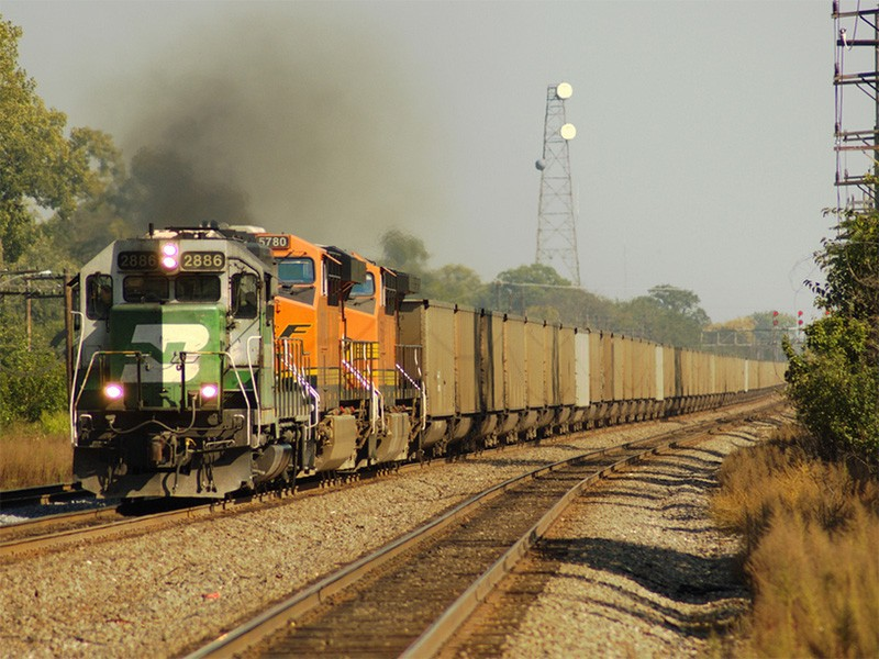 A BSNF train carrying coal.