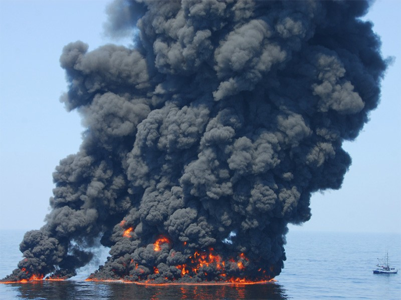 A controlled burn of oil from the BP oil spill sends towers of fire hundreds of feet into the air over the Gulf of Mexico on June 9, 2010.