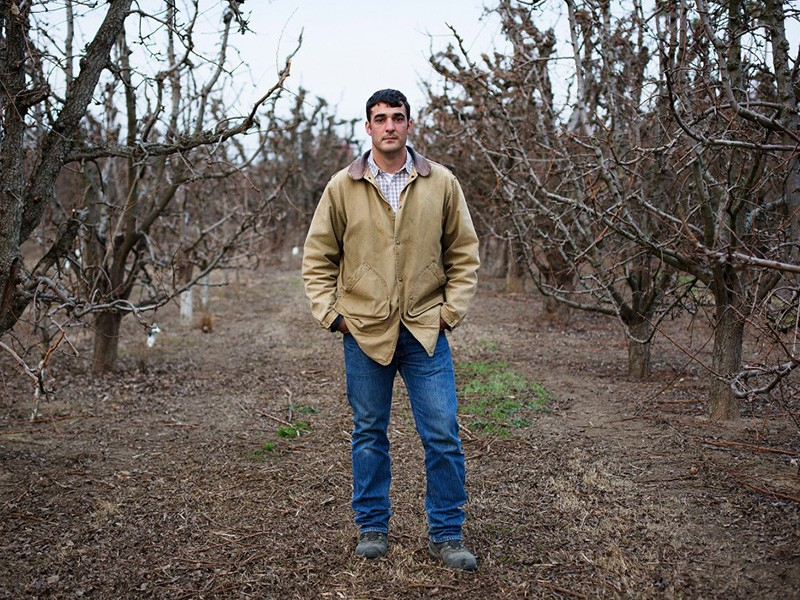 Brett Baker, a sixth generation farmer in the Delta, in his pear orchard.